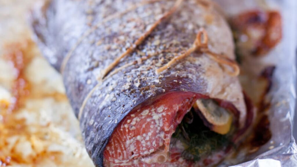 Whole cooked sockeye salmon with lemon and dill
