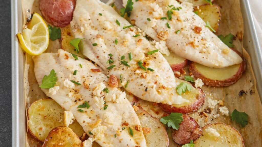 Baked petrale sole with lemon, potatoes and chives