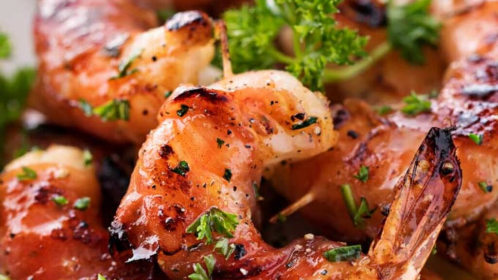 Prosciutto wrapped barbecued prawns